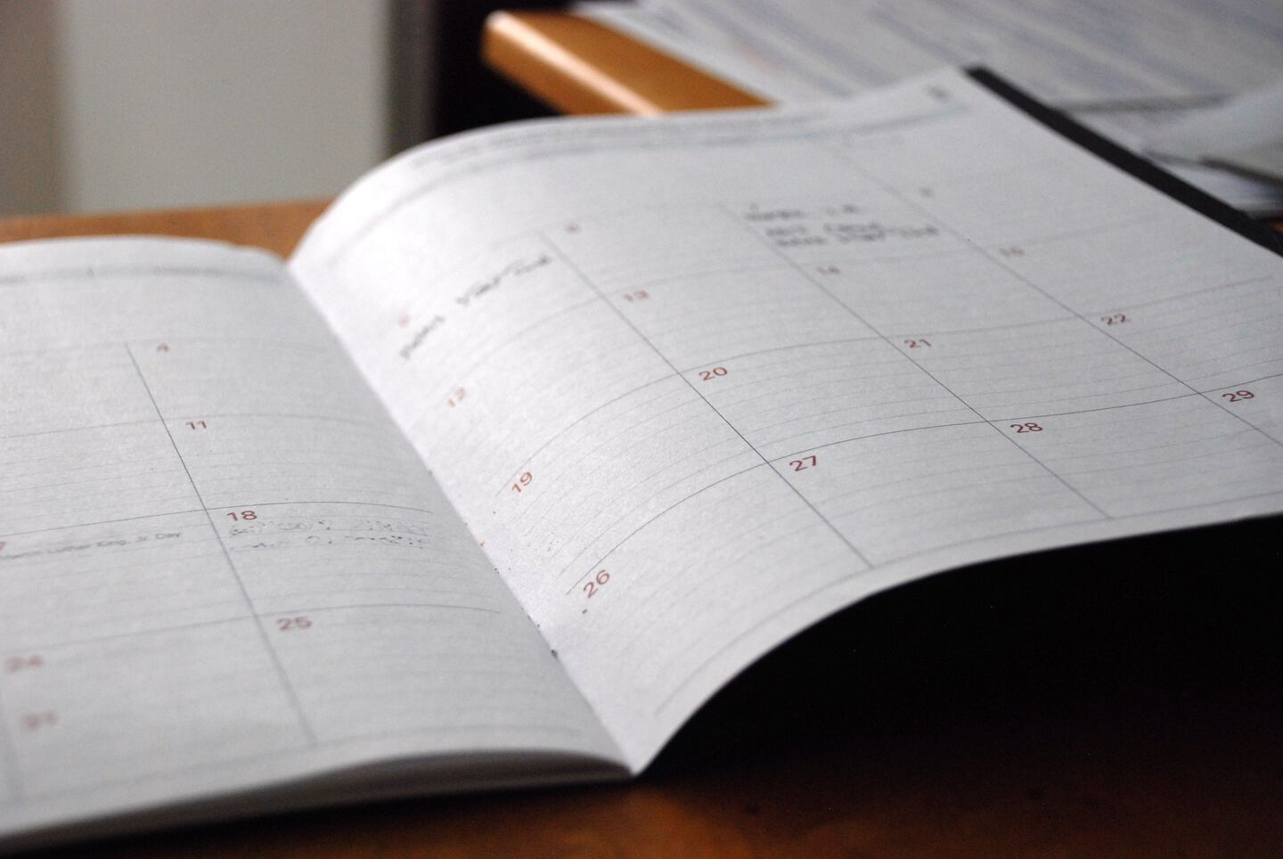 planner lying on table showing a calendar