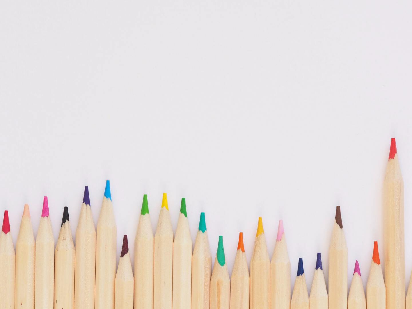 a full set of color pencils against a white background